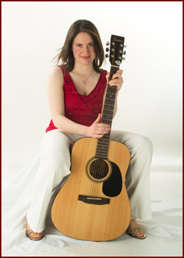 Aine Woods with her guitar.